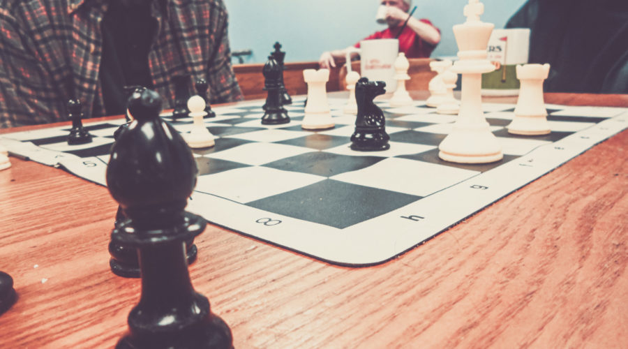 a game of chess on a wooden table